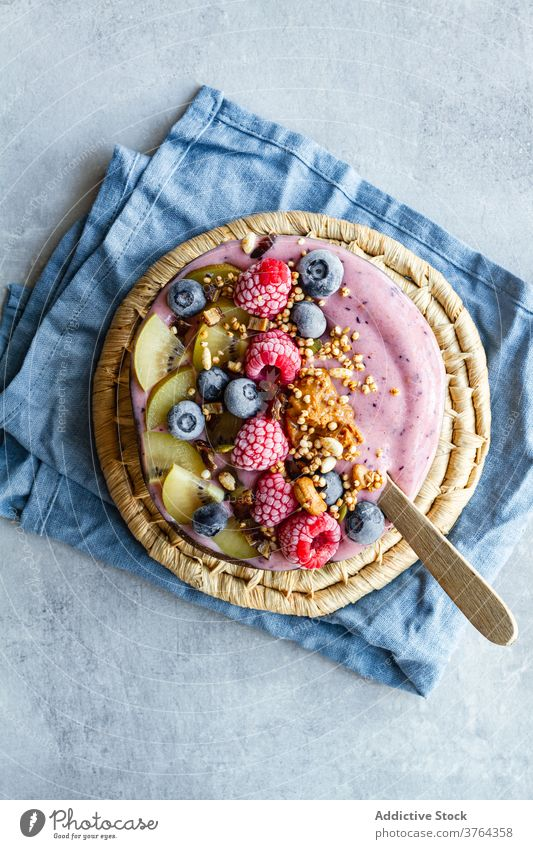 Appetizing smoothie bowl on table breakfast super food morning berry yogurt healthy delicious fresh fruit tasty yummy kiwi blueberry raspberry nutrition meal