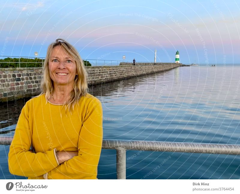 Smiling woman on the pilot island Schleimünde / Schleswig-Holstein Woman 45 - 60 years Lighthouse Adults portrait Blonde already Human being Baltic Sea wide
