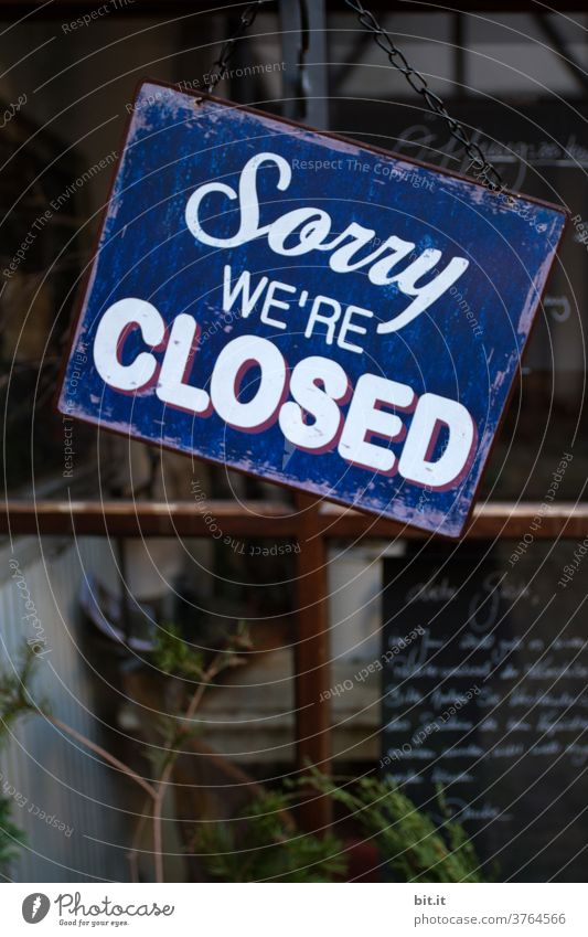 Sign, of a closed restaurant, in English. Closed unity closure too sorry Apology Signs and labeling sign Signage Characters Letters (alphabet) Typography Clue