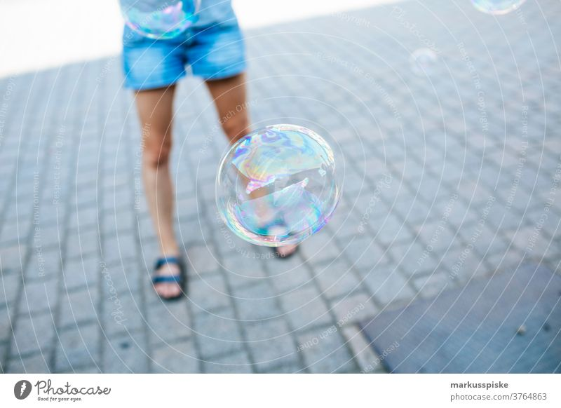 soap bubble away ball blow bubbles child circle clear clouds cloudy fly fun lucent mirroring optical reflection outside play playground playing puff reflexion