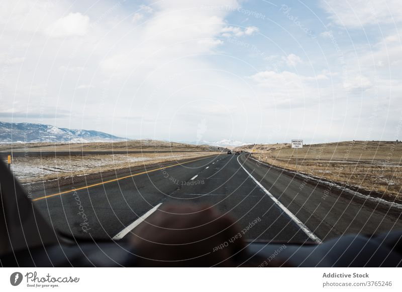Car riding on road among desert winter valley car drive mountain windshield route roadway travel highway asphalt usa united states america journey trip
