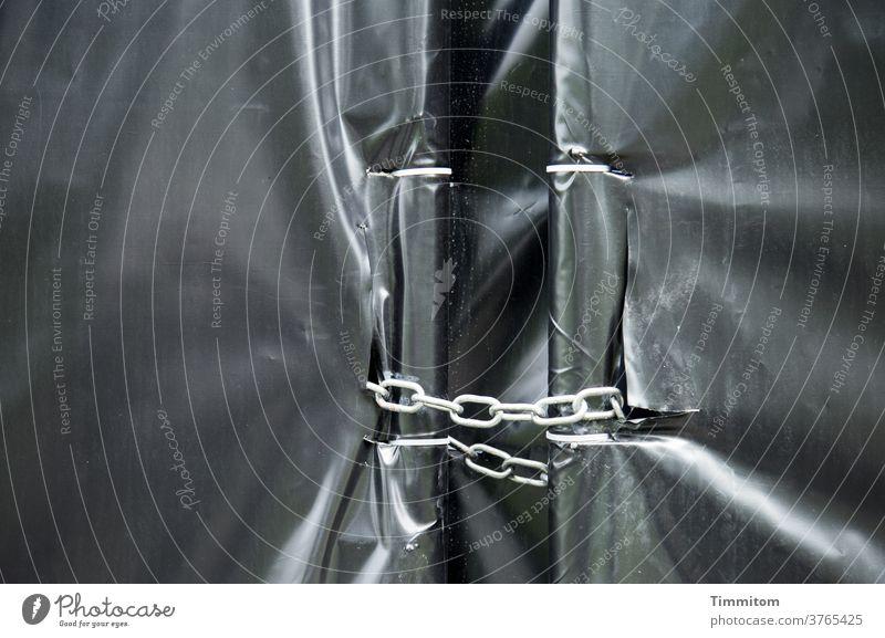 trapped in plastic | no escape tarpaulin crease Glittering Screening hide sb./sth. Protection Deserted Backup Chain Gray White