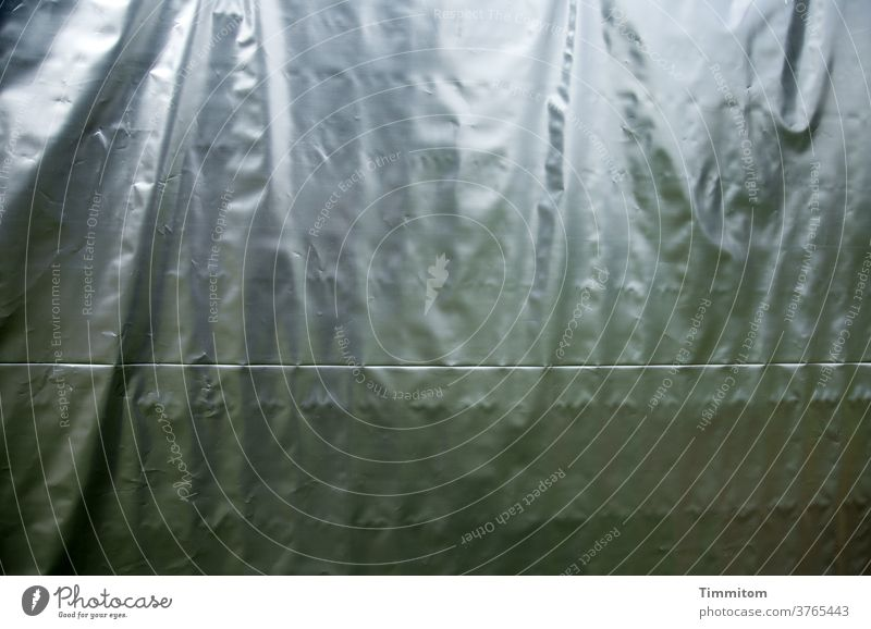 trapped in plastic   all that is behind tarpaulin crease Stitching Protection Plastic hide sb./sth. shine Deserted Exterior shot Screening