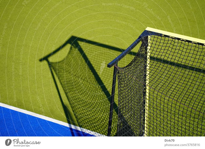 Hockey field, deserted Sports Goal hockey goal Light Visual spectacle Shadow play selective focus Network Goal net Line Baseline Playing Leisure and hobbies