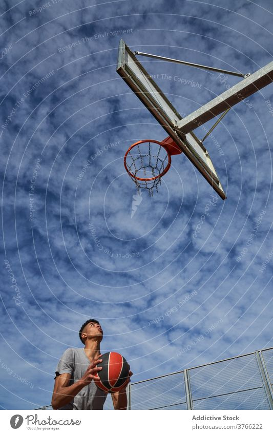 Male basketball player scoring ball in hoop score man game jump court male black african american ethnic sport athlete sportsman energy training activity motion