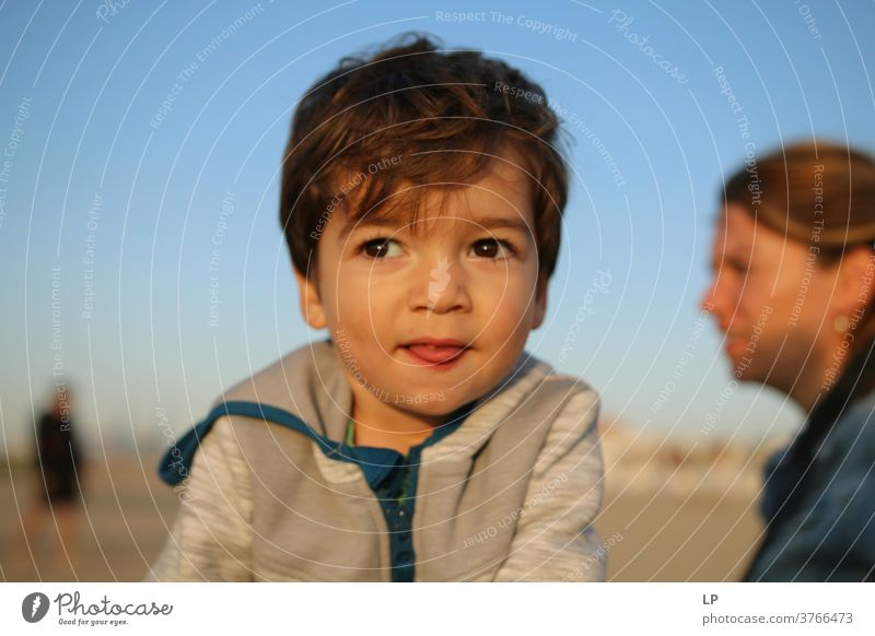 beautiful boy, facing the sun , eyes closed Front view Upper body Portrait photograph Sunbeam Contrast Shadow Light Structures and shapes Pattern Abstract