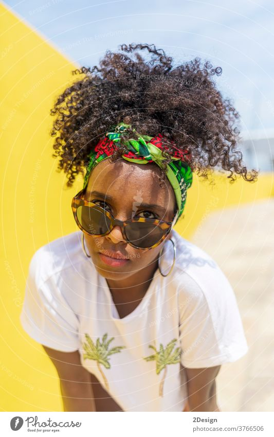 Attractive young african american woman with sunglasses and headband afro hair 1 black fashionable female hairstyle curly lady person beautiful girl beauty