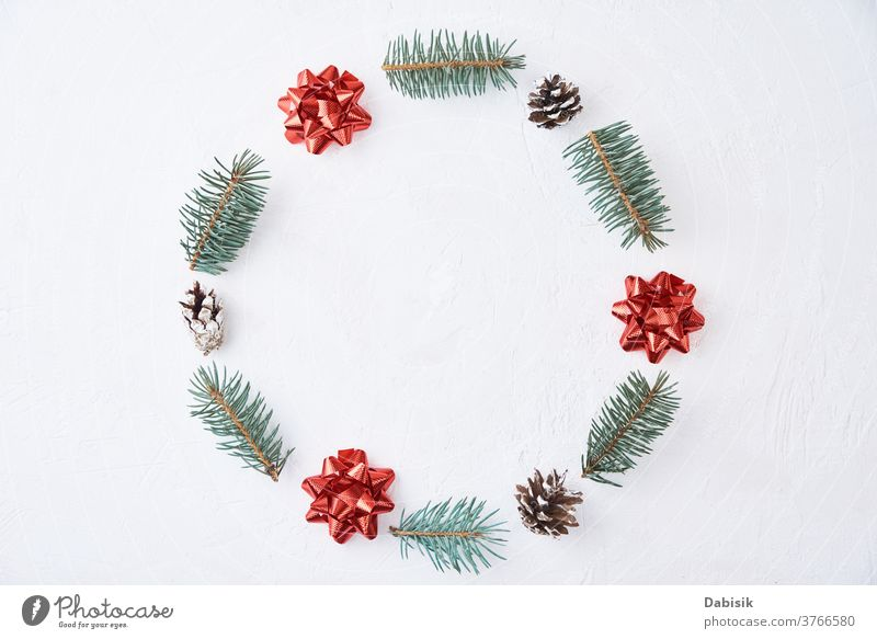 Christmas composition. Wreath made of fir tree branches and festive pine cones on a white background, top view christmas xmas decoration wreath holiday new year