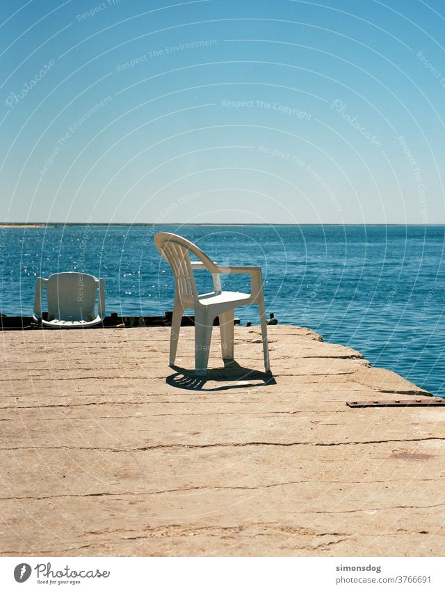 SUNPLACE sea view Chair Plastic chair Horizon Break outlook Midday sun Cloudless sky Blue Ocean