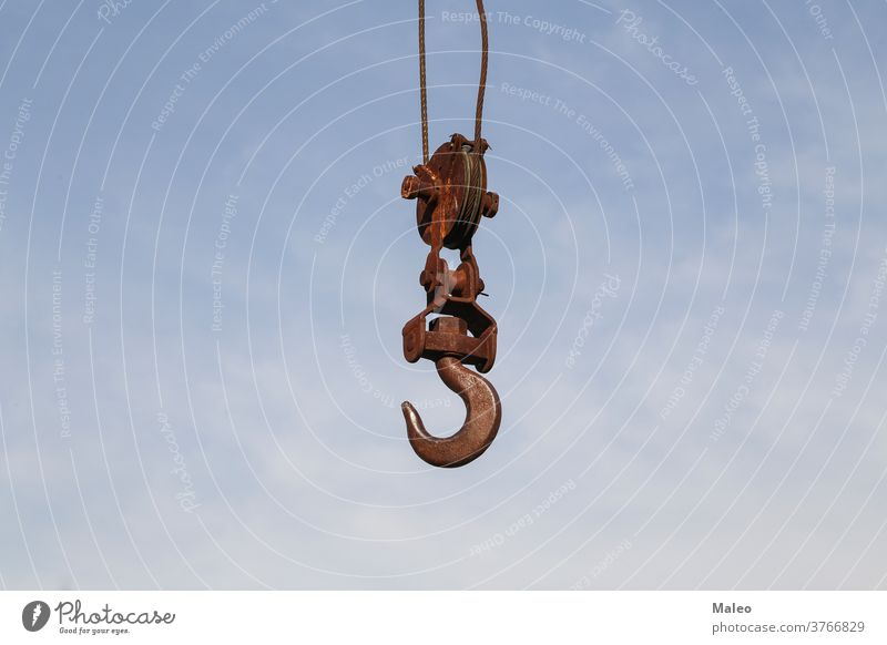 Old rusty hook of a hoisted crane in the port construction equipment industrial industry lift lifting machine old machinery metal steel heavy iron work sky
