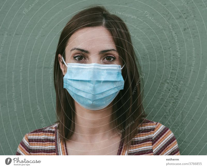 Close-up of young woman with medical mask coronavirus epidemic pandemic quarantine covid-19 symptom medicine health background blur positive test hospital city