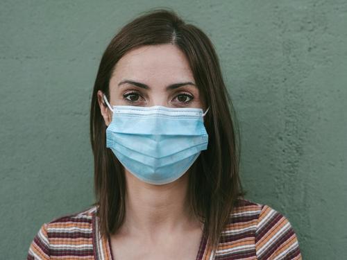 Close-up of young woman with medical mask coronavirus epidemic pandemic quarantine covid-19 symptom medicine health background blur positive test hospital city