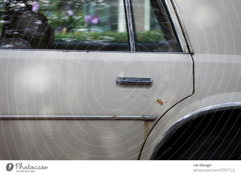 Detail of an old rusty car in side view Old Silver decorative stripes door Exterior shot Colour photo Vehicle Transport Street Vintage car Retro
