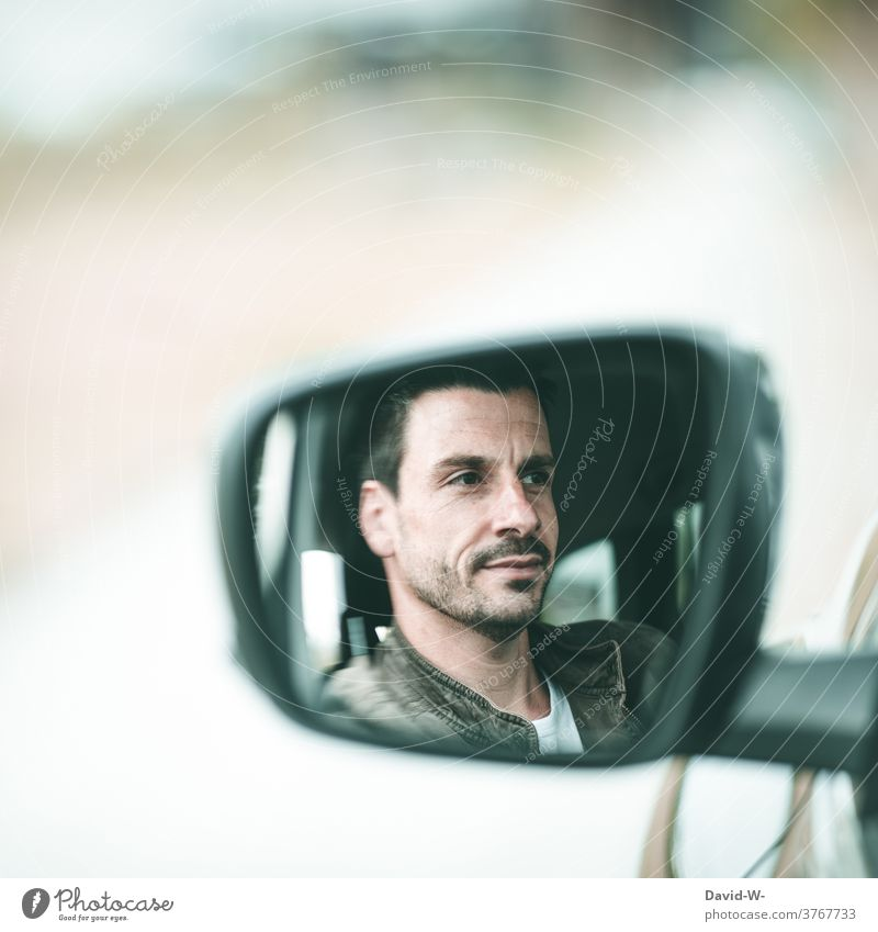 Man in side mirror of car car mirrors Side mirror Face Car driver Driving Mirror image left Calm cheerful Transport