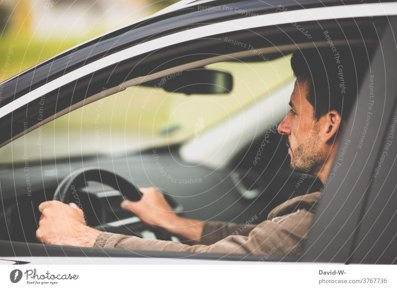 Man with the car on the road Motoring Car observantly Driving Concentrate tranquillity Self Control Serene Road traffic