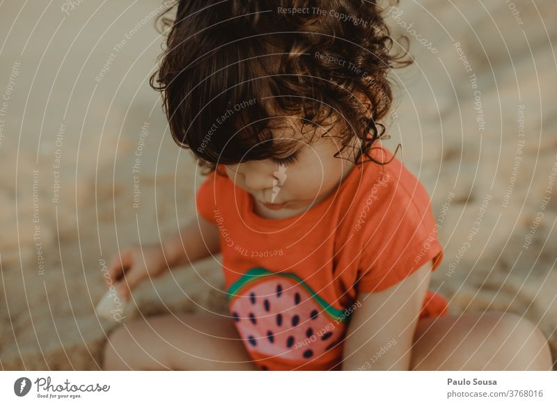 Little girl playing in the Sandy beach Beach Child Children's game Childhood memory Playing Beach vacation Ocean Colour photo Exterior shot Vacation & Travel