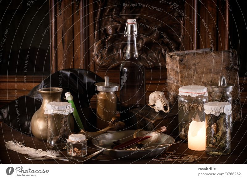 creepy witch kitchen with many disgusting ingredients for a magic potion, preserving jars and ancient utensils darkly lit with candlelight for Halloween