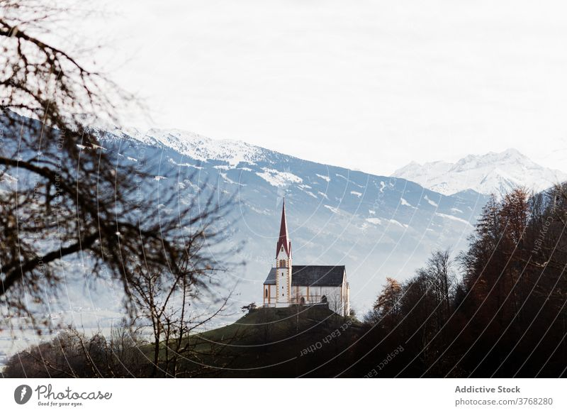 Church on hill in highlands in winter mountain church building landscape amazing snow range germany austria ridge majestic scenic wonderful small cold tranquil