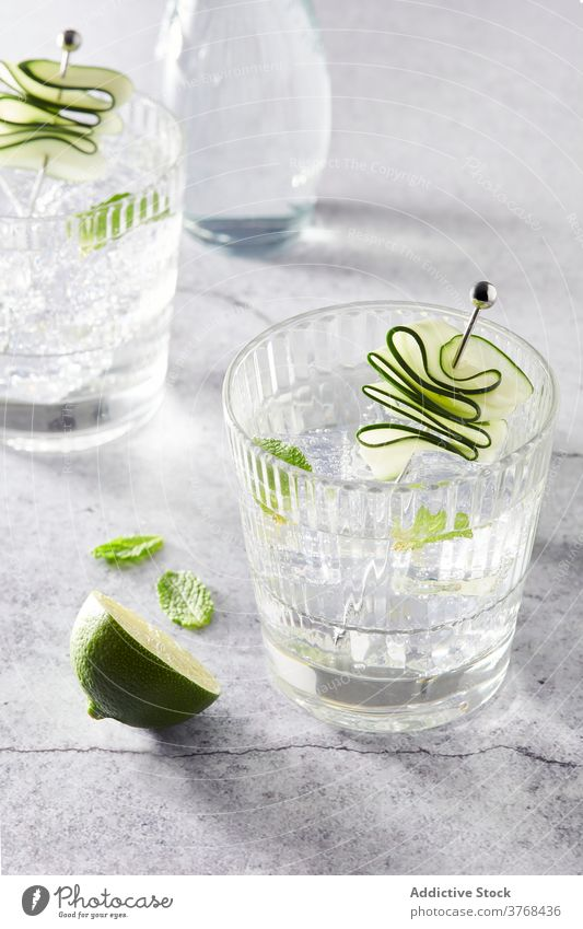 Tasty Mojito cocktails on table mojito drink ice refreshment alcohol lime cube beverage cold glass party summer tasty arrangement composition ingredient slice