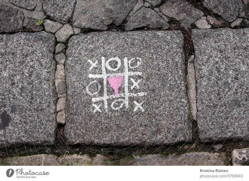 tic tac toe love wins Tic-tac-toe three wins Crucifix Crosses Circle circles Heart sweetheart Love X ö xoxo hugs kisses symbol symbolic Children's game box game