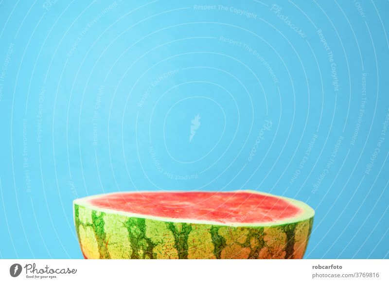 blue background with delicious watermelon open in half fresh juicy healthy food nature green organic diet red summer fruit pulp sweet dessert vitamin ripe part