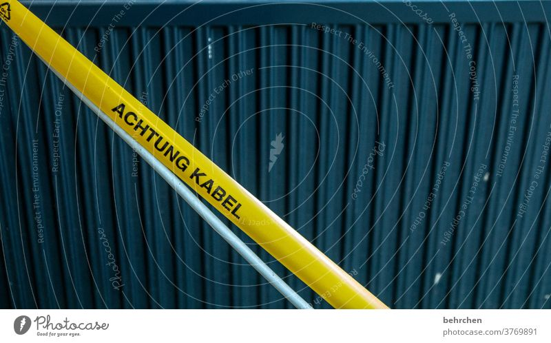ahhh, there's a cable! Cable Adhesive tape Warn Clue Construction site esteem peril attention Yellow Safety Risk of injury watch Caution Warning sign Signage