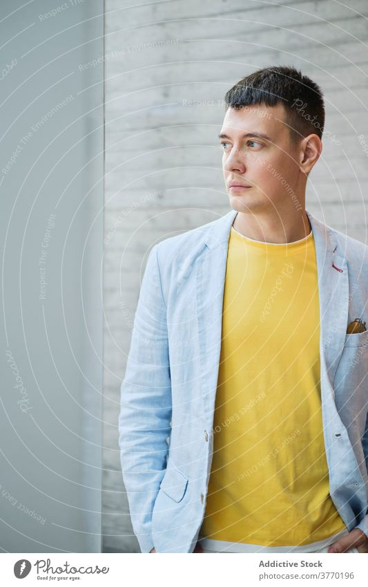 Stylish businessman in jacket in modern office entrepreneur style outfit serious workplace well dressed male trendy bright professional manager job success