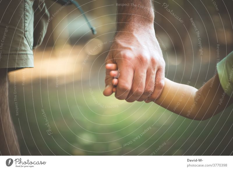 Helping hand - father and child hold hands Parents Considerate Child Love Safety (feeling of) Trust Father proximity Responsibility Emotions Together