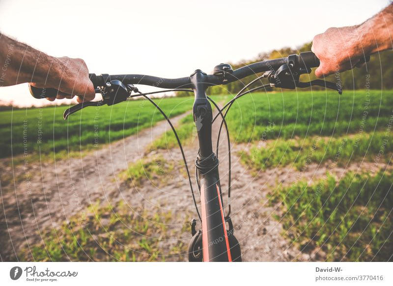 Cycling / cycling through nature Cycling tour Steering Bicycle Man salubriously Nature Movement Trip In transit especially cyclists Handlebars Lanes & trails