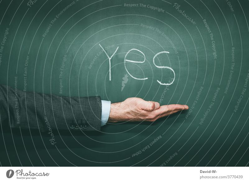 YES - hand points to something yes Yes Americas Positive Result choice Word English USA Remark Chalk Blackboard