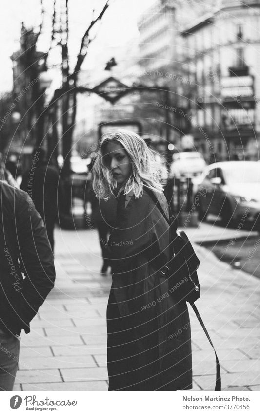 Portrait of a Caucasian blonde walking in the street. Uban background. urban Portrait photograph Blonde Russian Woman Street Lifestyle Black & white photo