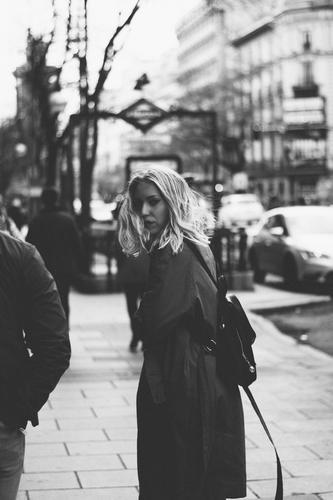 Portrait of a Caucasian blonde walking in the street. Uban background. urban Portrait photograph Blonde Russian Woman Street Lifestyle Black & white photo