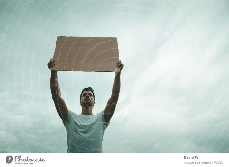 Man demonstratively holds up a sign in the air Strike Freedom of expression Fairness Society Poster Demonstration Protest Politics and state hands Uphold