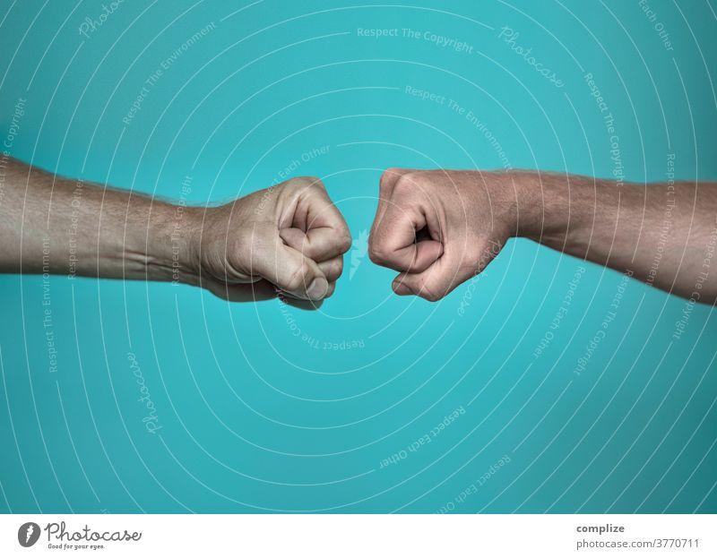 Faust greeting ghetto fist corona Virus Infection contact Fist Welcome welcome Ghetto fist bump transfer Contact handshake salute Communicate Men`s hand by hand