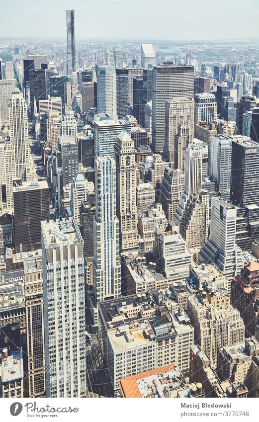 Retro toned aerial view of Manhattan, New York City, USA. new york city building business skyscraper skyline retro vintage filtered above urban architecture