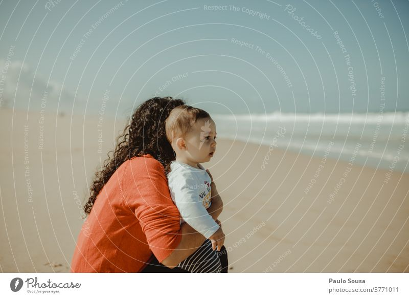 Mother and child watching the sea motherhood Child Son Family & Relations Together togetherness care Joy Smiling Life Happy Adults Parents Love Lifestyle