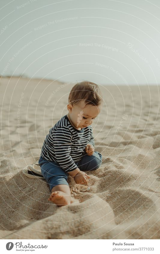 Toddler playing in the Sandy beach Child childhood Vacation & Travel Ocean nature Summer Childhood memory Exterior shot Infancy Beach Playing Lifestyle Cute