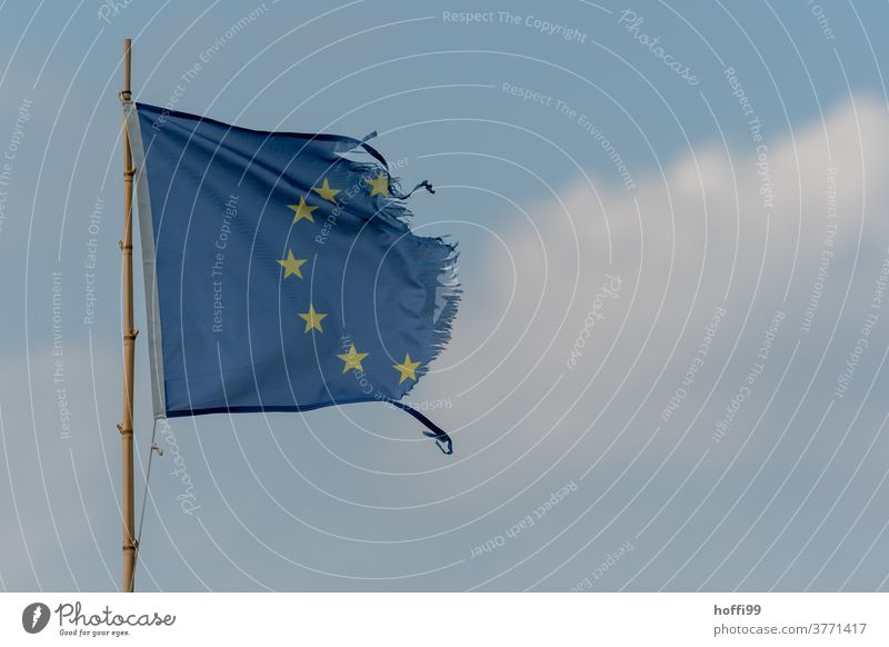 European flag - tattered by the wind Tattered Decline Star (Symbol) Symbols and metaphors Politics and state disintegrate decay Transience Sadness sad