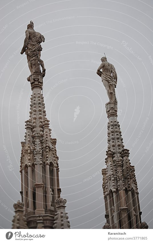 Filigree lace and turrets with stucco work and figures on the roof of the Milan Cathedral. Sky Gray sharpen tower Tower Work of art Architecture Dome Church