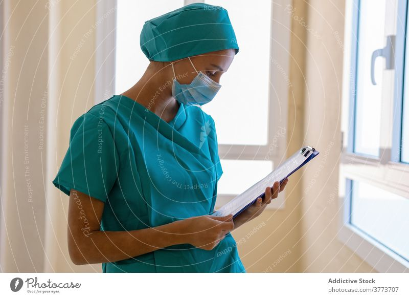 Nurse writing on clipboard in hospital nurse write take note medic woman clinic work medical young female professional medicine occupation staff health care