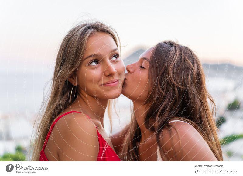 Tender lesbian couple kissing at sunset lgbt women tender hug relationship same sex love sundown summer together happy girlfriend bonding embrace romantic equal