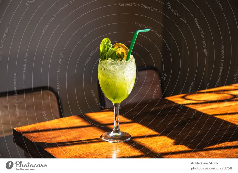 Green refreshing cocktail with mint green lemon glass drink alcohol cold ice bar straw beverage goblet refreshment cool pub citrus slush appetizing colorful