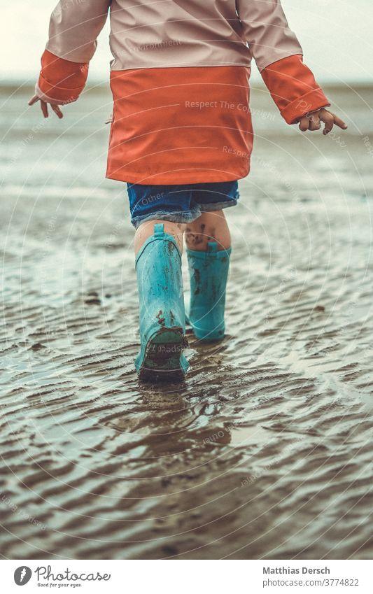 Walk in the Wadden Sea To go for a walk stroll Child children Rubber boots Mud flats watt Beach Walk on the beach Beach life Ocean North Sea North Sea coast