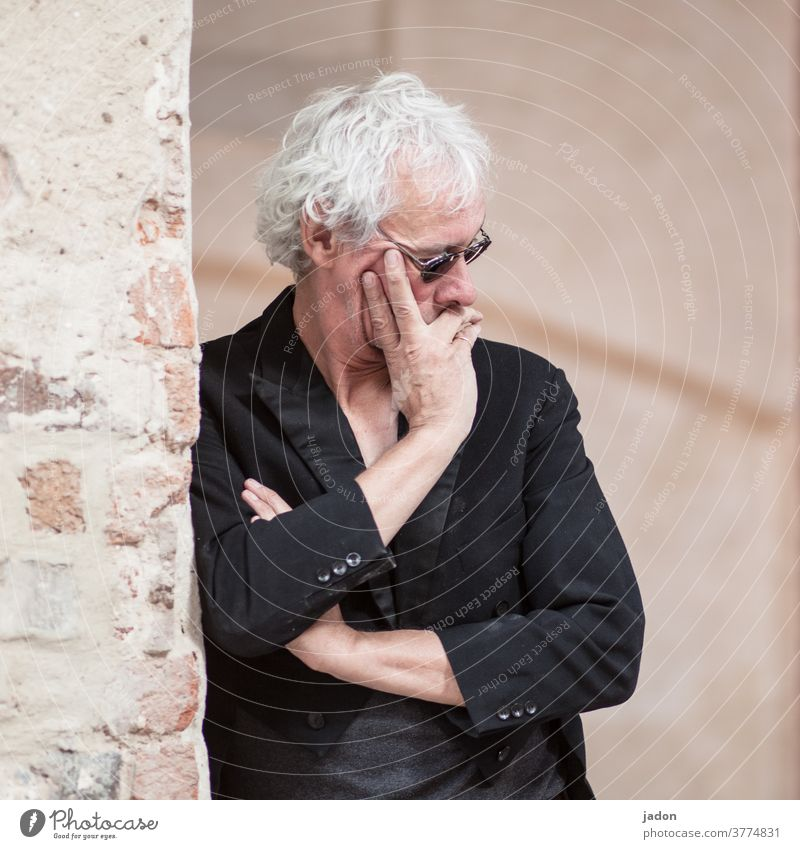 ...in thought. Man Only one man portrait Individual black tailcoat Gray-haired Sunglasses Wall (building) Wall (barrier) piers Ajar arms crossed Hand on face