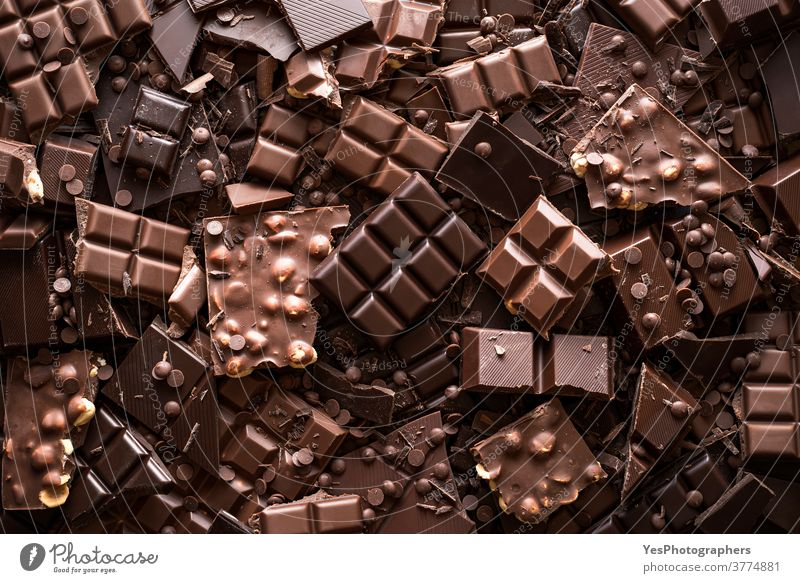 Chocolate assortment background. Top view of different kinds of chocolate abundance assorted baking bitter black brown chips chocolate bar chocolate chips