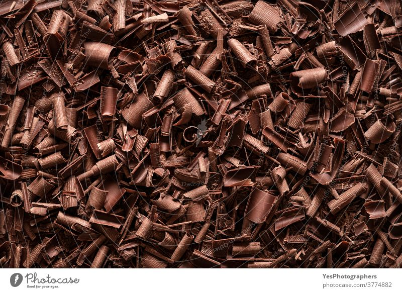 Chocolate pieces background. Top view of chocolate shavings above view baking bitter black brown chopped christmas chunks confectionery cooking couverture curl