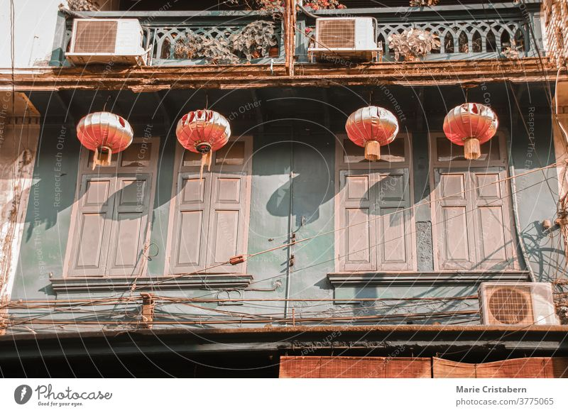 Chinese lanterns hanging on old historic buildings in the heritage site of Yaowarat Road or Chinatown in Bangkok City heritage town yaowarat road chinatown