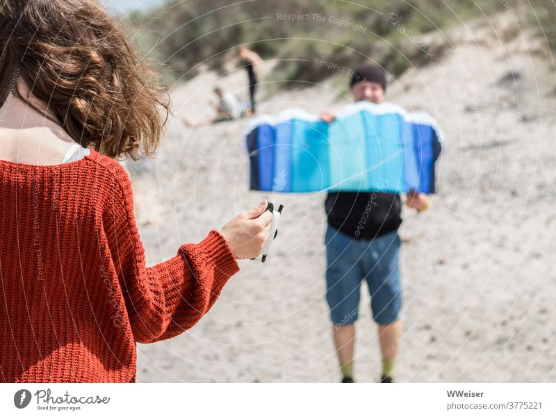 Kite flying requires a good coordination between father and daughter kites Wind Beach Sun Flight Mat steering mat Father Girl Daughter Child Curl hair Sweater