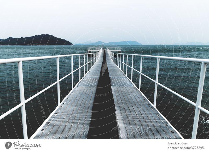 White boat jetty reaching into the sea, Naoshima, Japan naoshima ocean water wave coast sky bay beach horizon islet landscape shore japan melancholy daytime