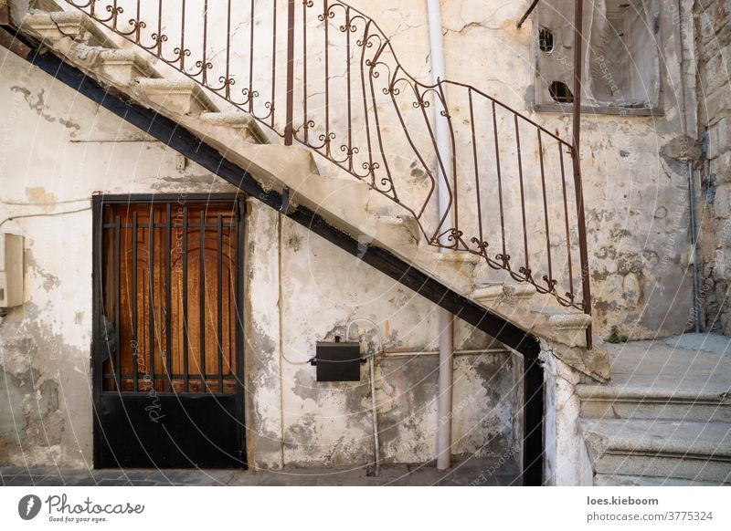 Tyre, Lebanon - October 8 2015: Traditional stair entrance with broken handle of Lebanese house in Tyre, Lebanon Middle East Arabic architecture exterior old